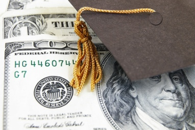 mini graduation cap on money, by SalFalk